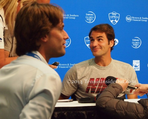 Adorable bemused Federer press talk interviews photos pictures images 2014