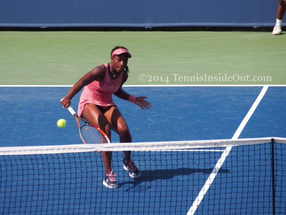 Sloane Stephens volley tennis ball pink dress visor photos images pictures