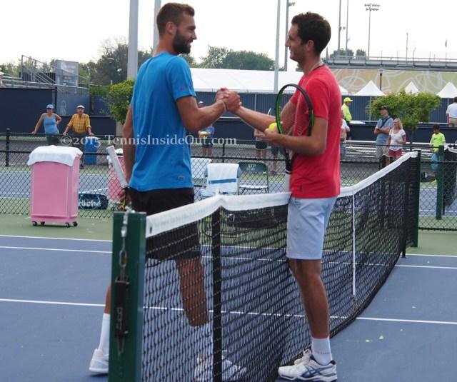 Handshake between Benoit Paire and James Ward at practice in Cincinnati