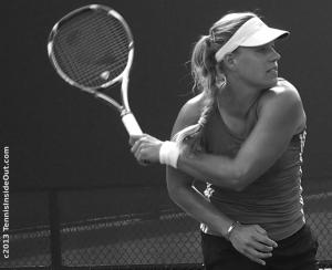 Backhand slice German Angelique kerber racquet visor crossed arms Cincinnati Western and Southern Open Masters 2013 practice pics