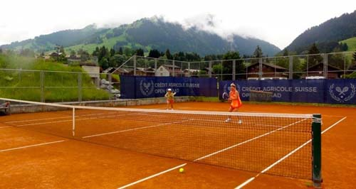 Red-clay court and clinic during Roy Emerson Tennis Week