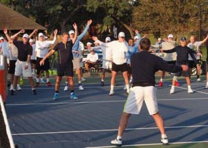 Larry Starr and warm-up at Newcombe's Tennis Legends Week