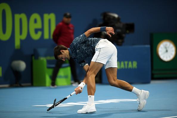 Doha   Djokovic loses – and his rag