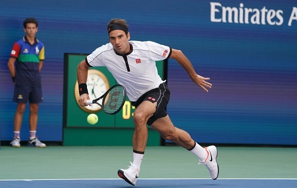 New York | Federer eases past Evans