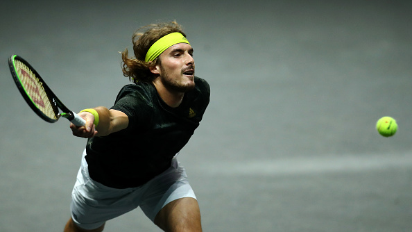 Tstsipas scrambles through to Rotterdam semis.