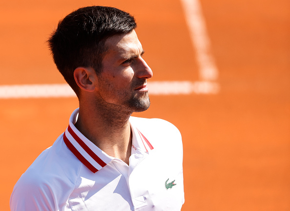 Djokovic cruises through but refuses to commit to vaccination
