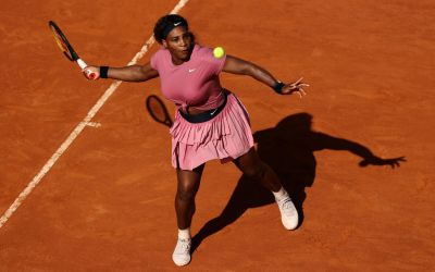 Serena wins first match on clay as Venus falters in God's wind