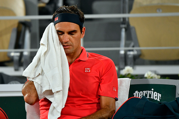 Federer wins but could pull out of French