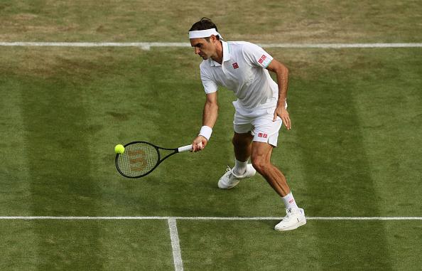 Federer romps past Gasquet