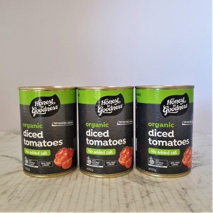 Three tins of unopened, diced tomatoes