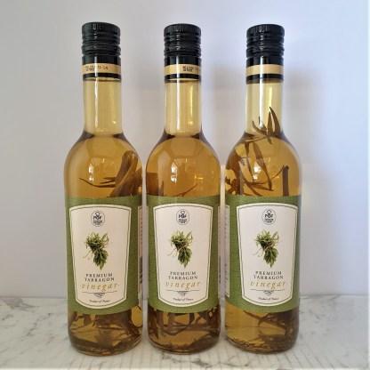 Three bottles of tarragon vinegar