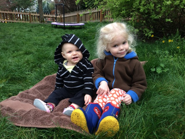 sisters sitting in the grass outside