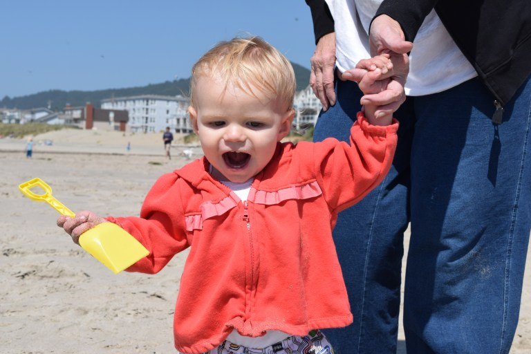 The beach is full of fun—and opportunities to dig sand!—for toddlers. Ten Thousand Hour Mama