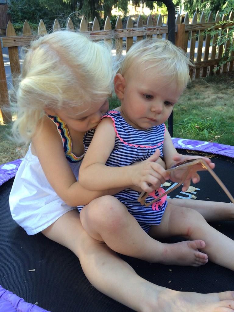 My preschooler is her little sister's biggest fan and cheerleader. Ten Thousand Hour Mama