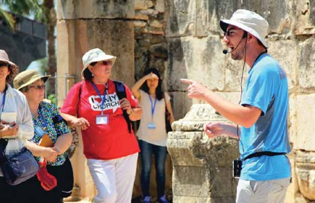 Andre makes his point at Capernaum synagogue