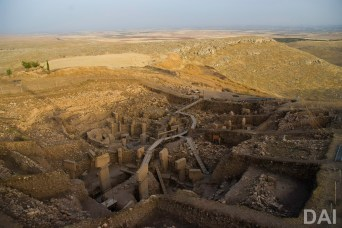 View of Göbekli Tepe's so-called main excavation area, Enclosure D in the front. (Photo: German Archaeological Institute, Nico Becker)