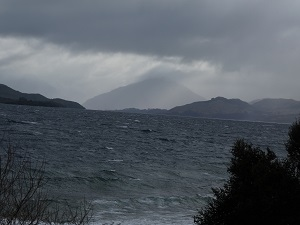 Mt Alfred with storm clouds surrounding it and over the lake