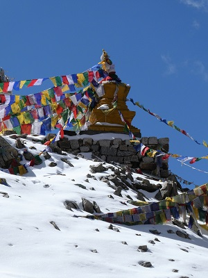 Prayer flags adorn the small stupa on Khardung La Pass
