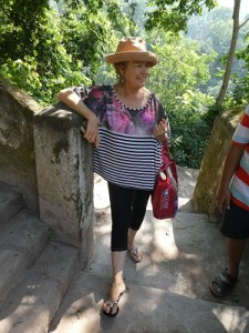 Phyllis on the steps near Vasuvistha Gufa Cave
