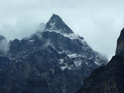 Stunning peak amongst the mist near Badrinath and Mana Village, Himalayas India