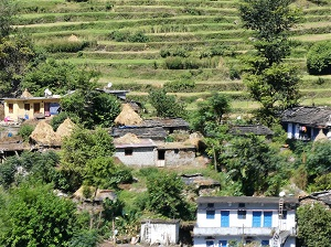 Rice terraces, slate rooved houses, hay stacks and village people, Himalayan India