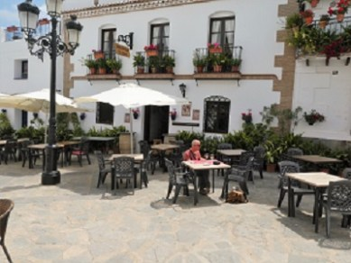 Last lunch diners at the restaurant on the square Canillas de Albaida