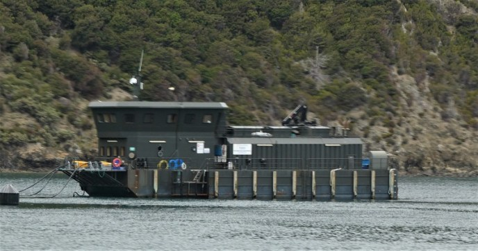One of the vessels used to store food for the salmon farms