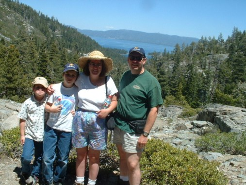 photo of the author with her children and husband, standing in front of Eagle Lake