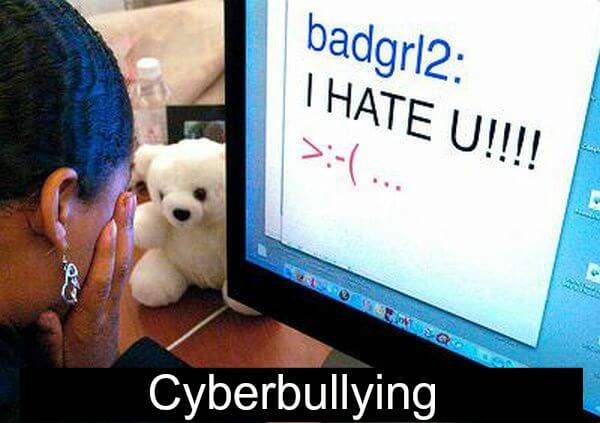 girl crying in front of computer which reads badgirl2: I HATE U!!!! >:(...  with the title Cyberbullying