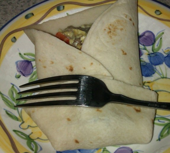 sausage pepper breakfast burrito with a fork