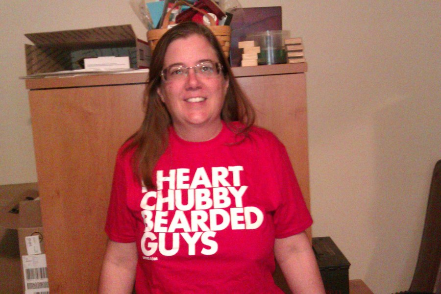 photo of the author wearing a red t-shirt which reads I Heart Chubby Bearded Guys