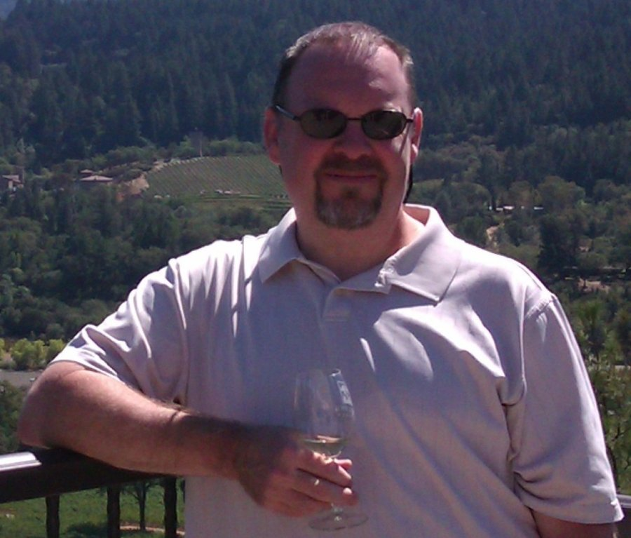 photo of the author's husband holding a wine glass