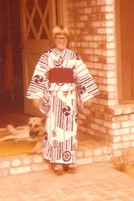 the author at age 10 wearing her black and white kimono with red sash and Japanese sandals
