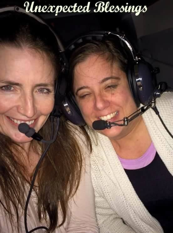 the author and her friend, wearing aviation headsets