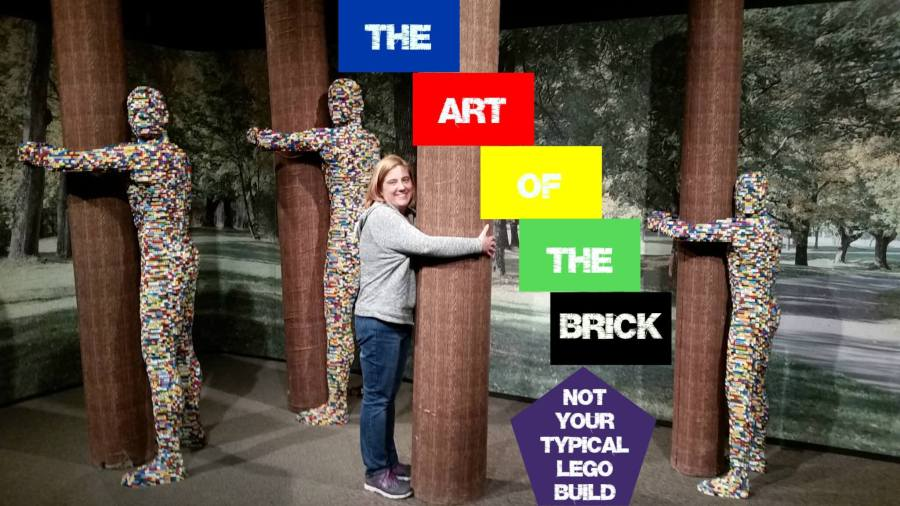 """the author, pretending to be a Lego person holding a tree with the title """"The Art of the Brick: Not Your Typical Lego Build"""""""