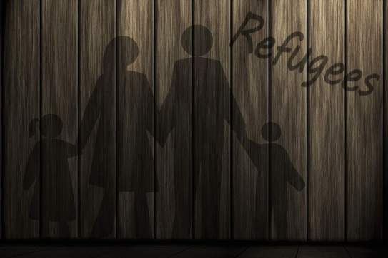 Drawing of a refugee family on fence