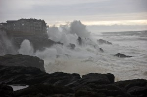 Waves pound a beach and structure between Depot Bay and Boiler Bay on the Oregon Coast. (Photo: Erica Harris, Oregon State University)
