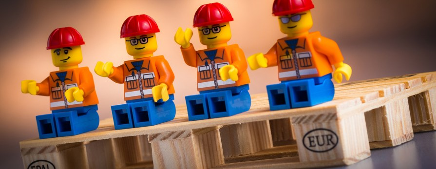 lego construction figures on pallet