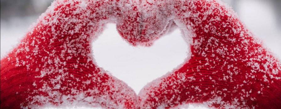 red mitten hands shaped as heart