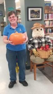 Patron holding pumpkin