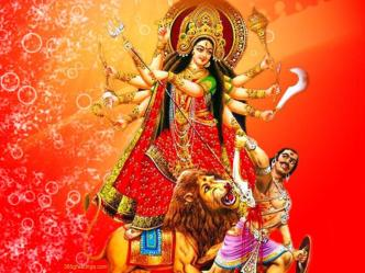 Durga stands on a lion and wields the eight weapons gifted to her by the gods to slay the buffalo-demon.