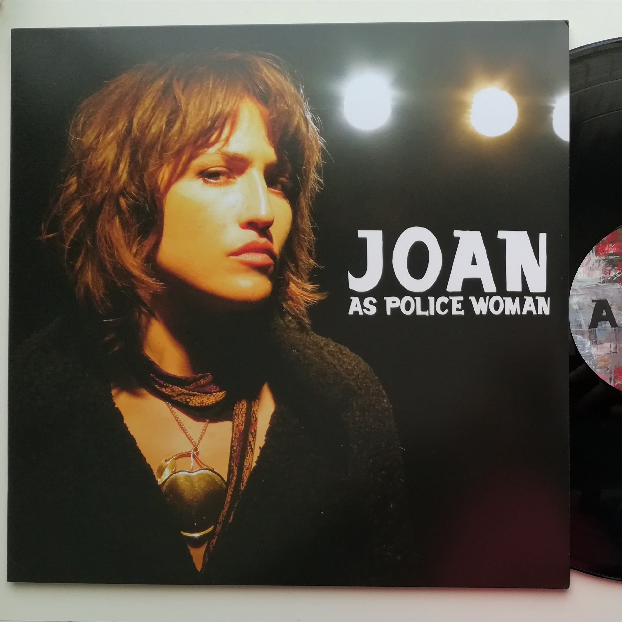 Joan as a police woman.