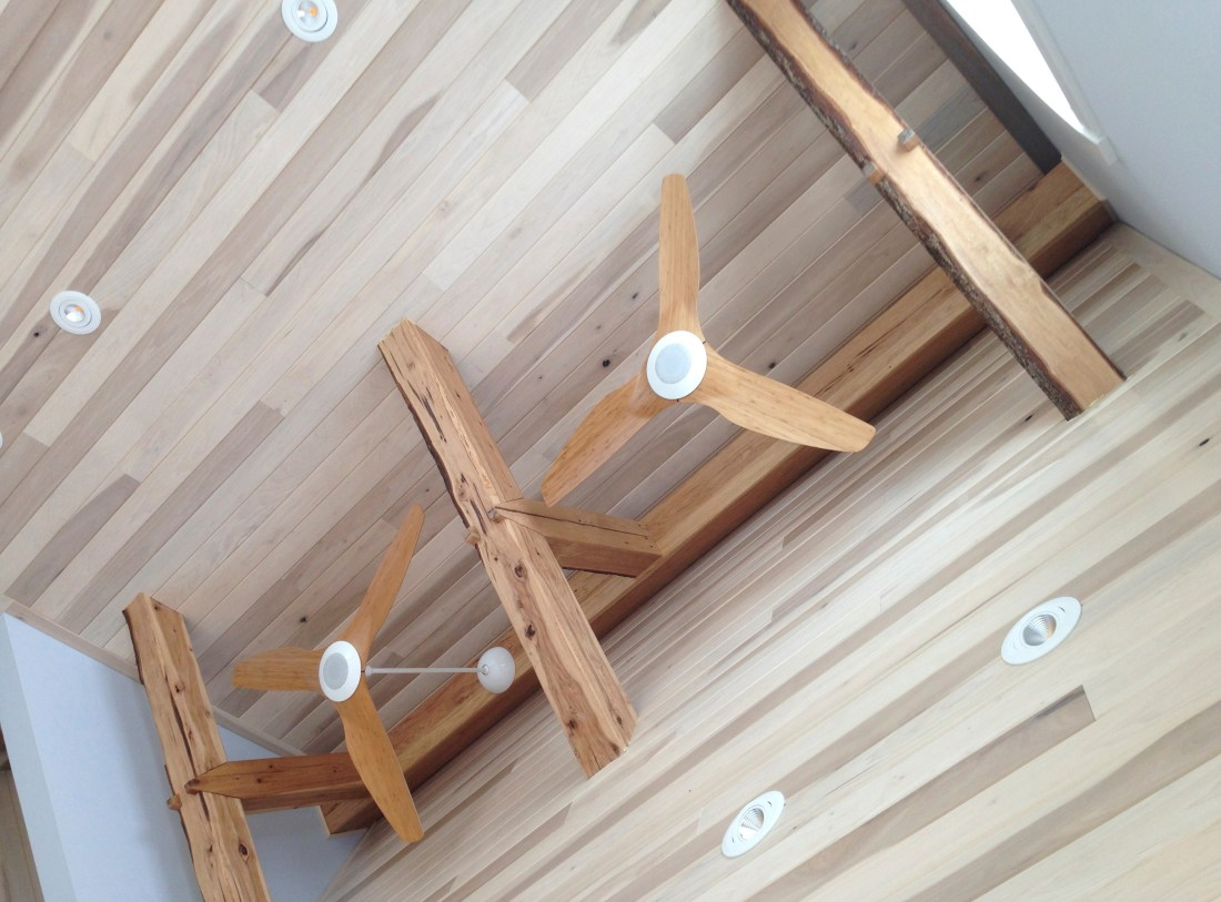 hickory beams hand hewn by skilled craftsman for beach house rafters