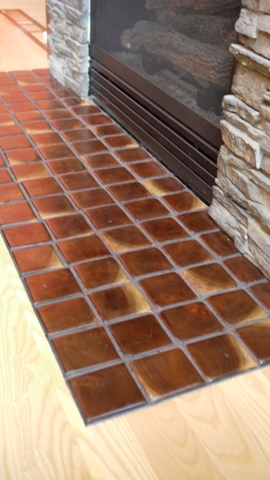 end grain walnut tiles fireplace hearth made of walnut custom for client of Terrawood