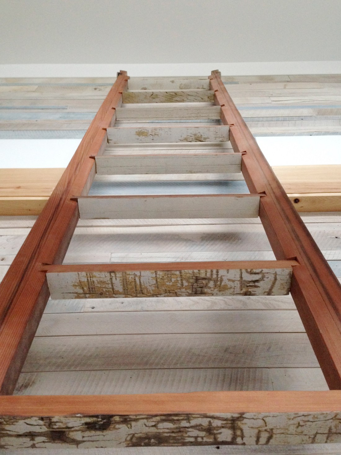 reclaimed red wood to produce a usable and functional indoor ladder
