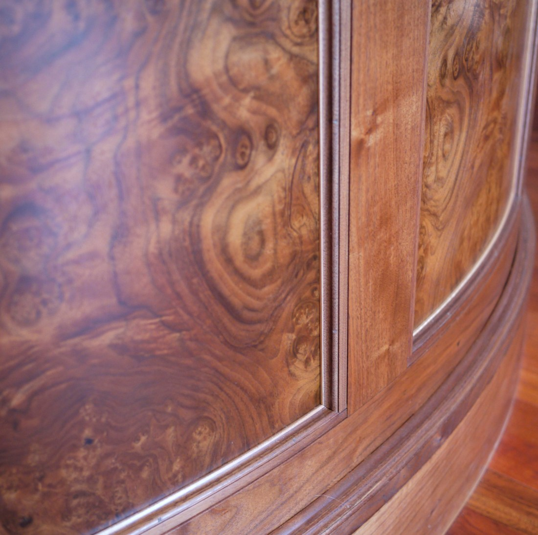 intense walnut burl veneer on curved bar front with maple accent trim