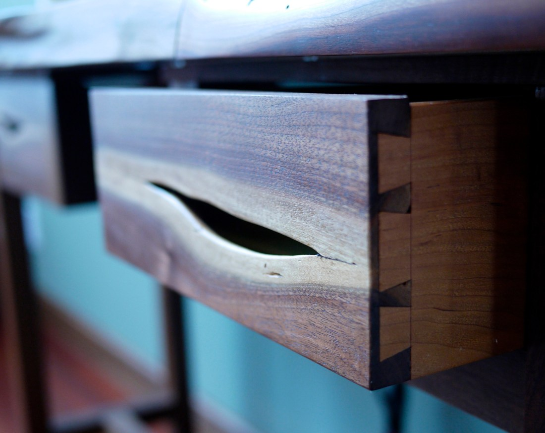 close up of hand cut half blind dovetail joinery on walnut and maple