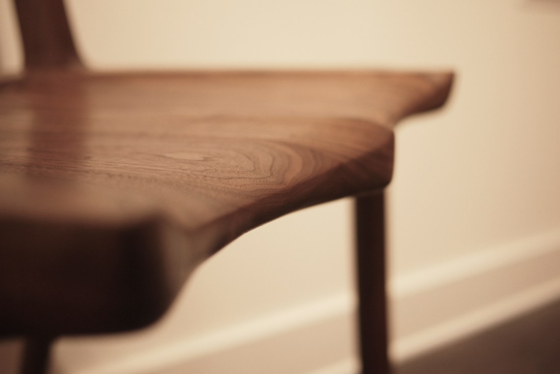 close up on shaped chair seat made of walnut by Terrawood design