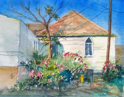 St. John's Episcopal Church in Old Bisbee cradled a garden of blooms that surrounded a lonely fire hydrant.