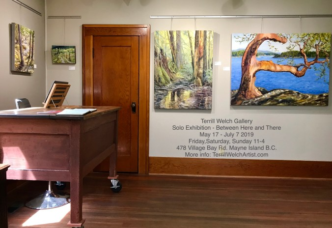 art gallery with contemporary impressionist landscape paintings of trees in rain forest and arbutus tree reaching over a cliff towards the sea